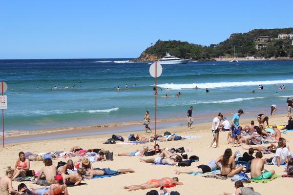 Sonnenbad am Manly Beach
